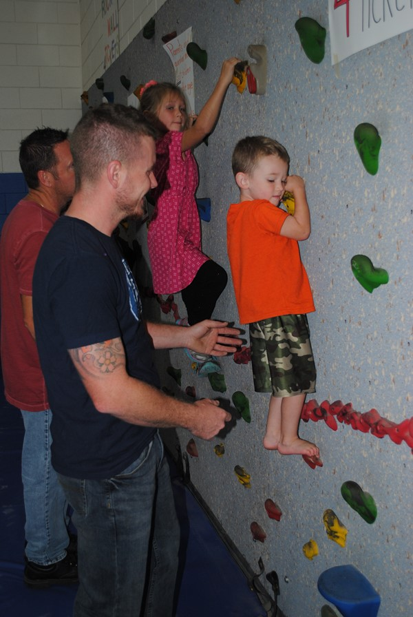 Climbing the rock wall at Fall Festival