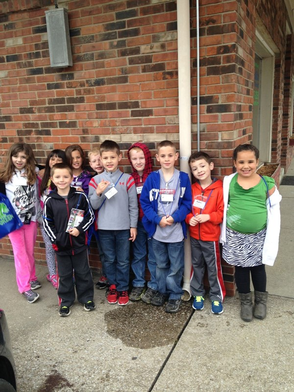 Photos from the First Graders' Field Study where they learned about careers from local businesses and service providers on Main Street.